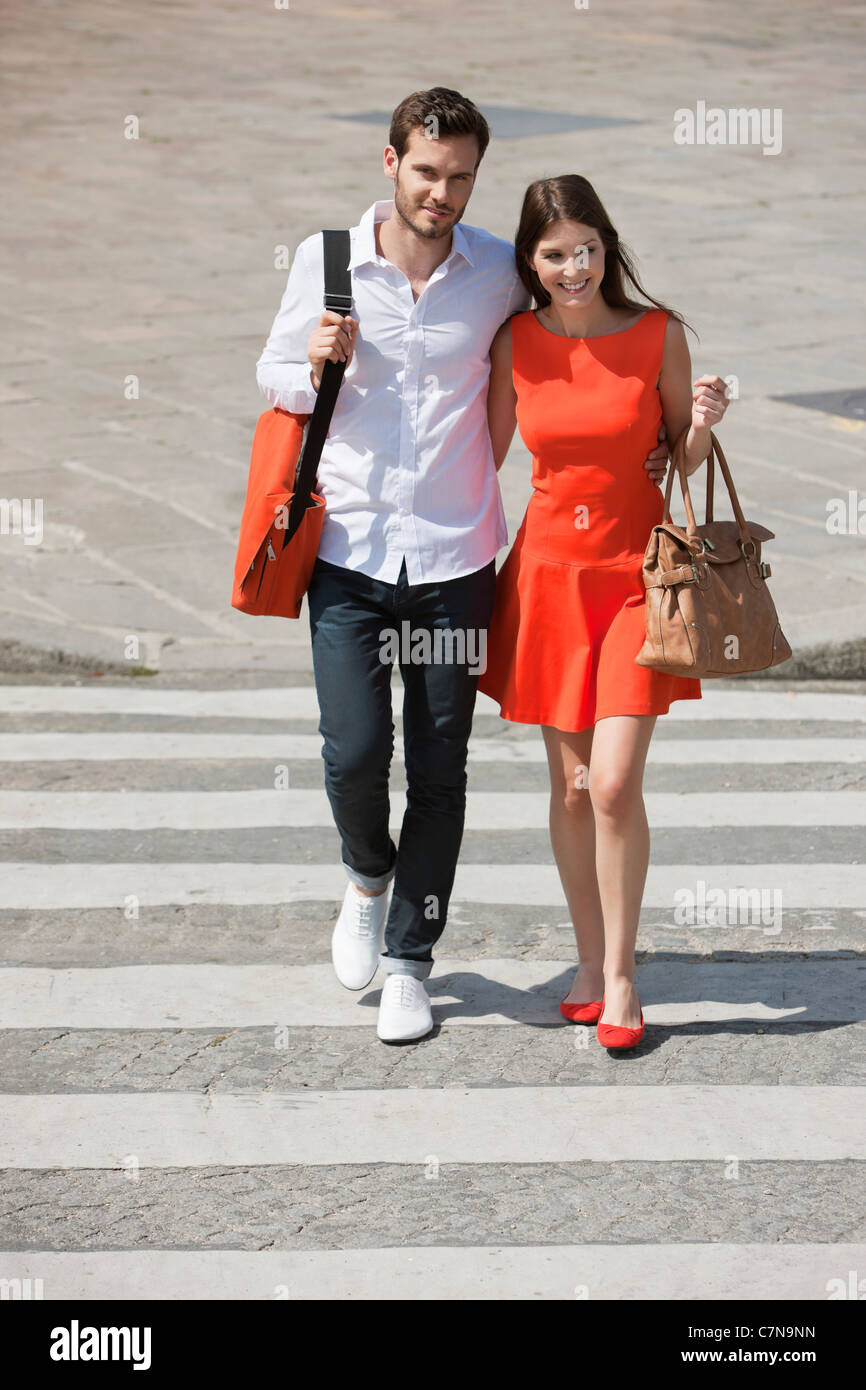 Couple on a crosswalk, Paris, Ile-de-France, France - Stock Image