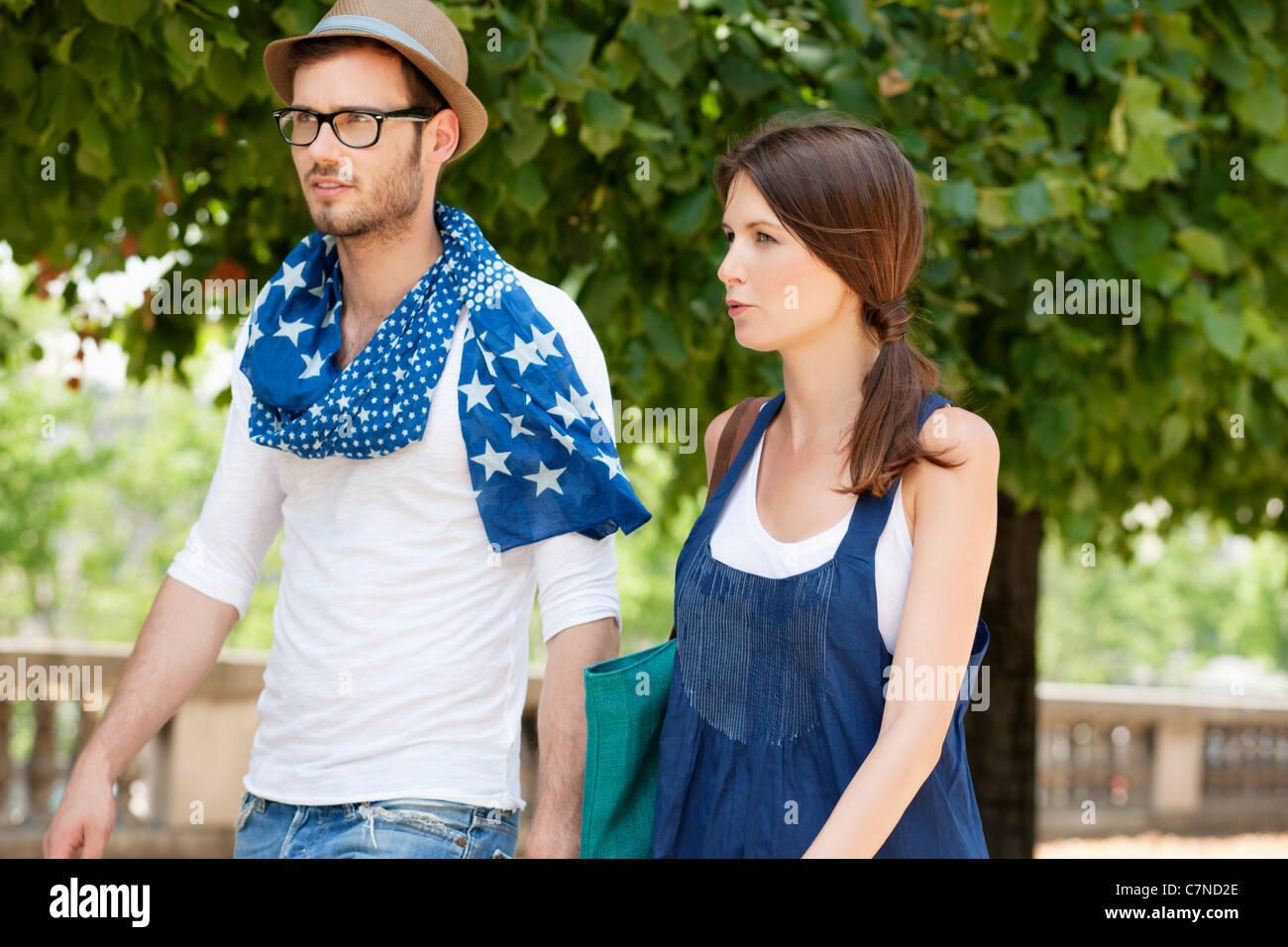 Couple walking together, Paris, Ile-de-France, France - Stock Image