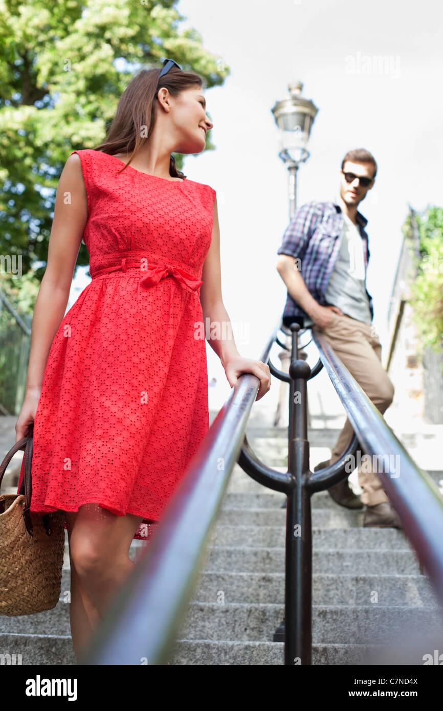 Couple on staircases, Montmartre, Paris, Ile-de-France, France - Stock Image