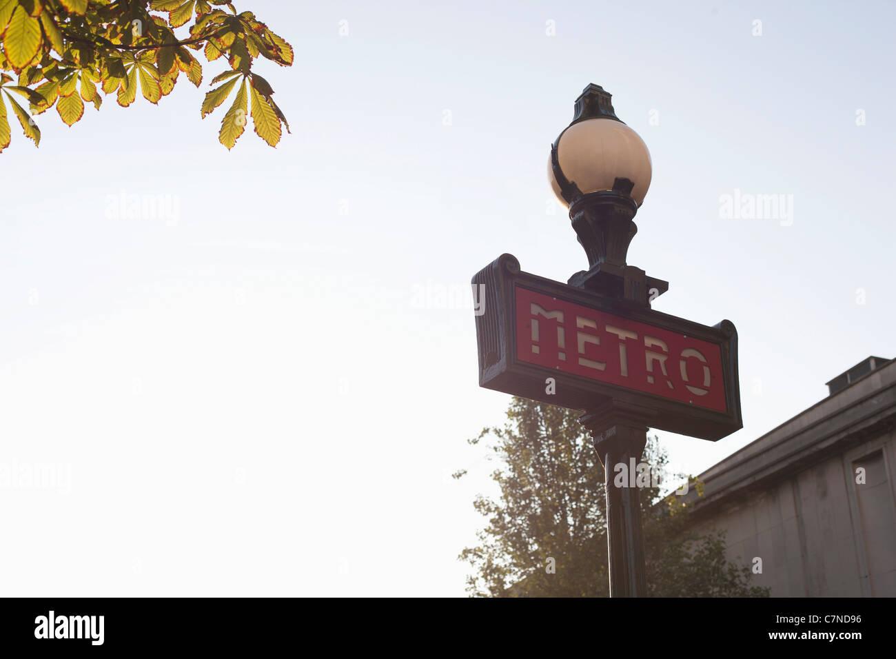 Low angle view of Metro sign, Paris, Ile-de-France, France - Stock Image