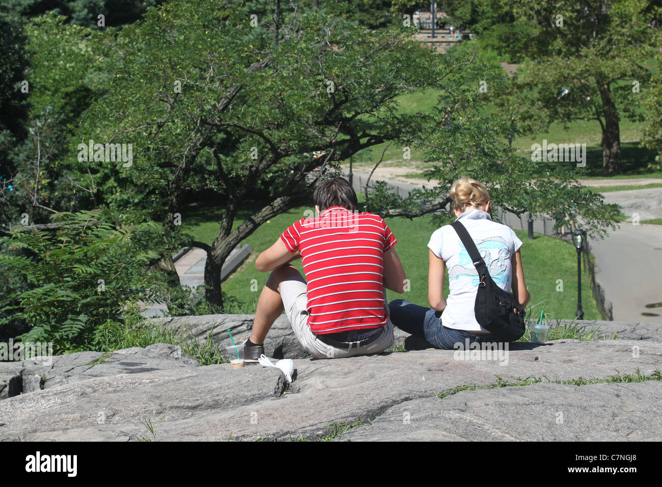 A couple sitting together in Central Park Stock Photo