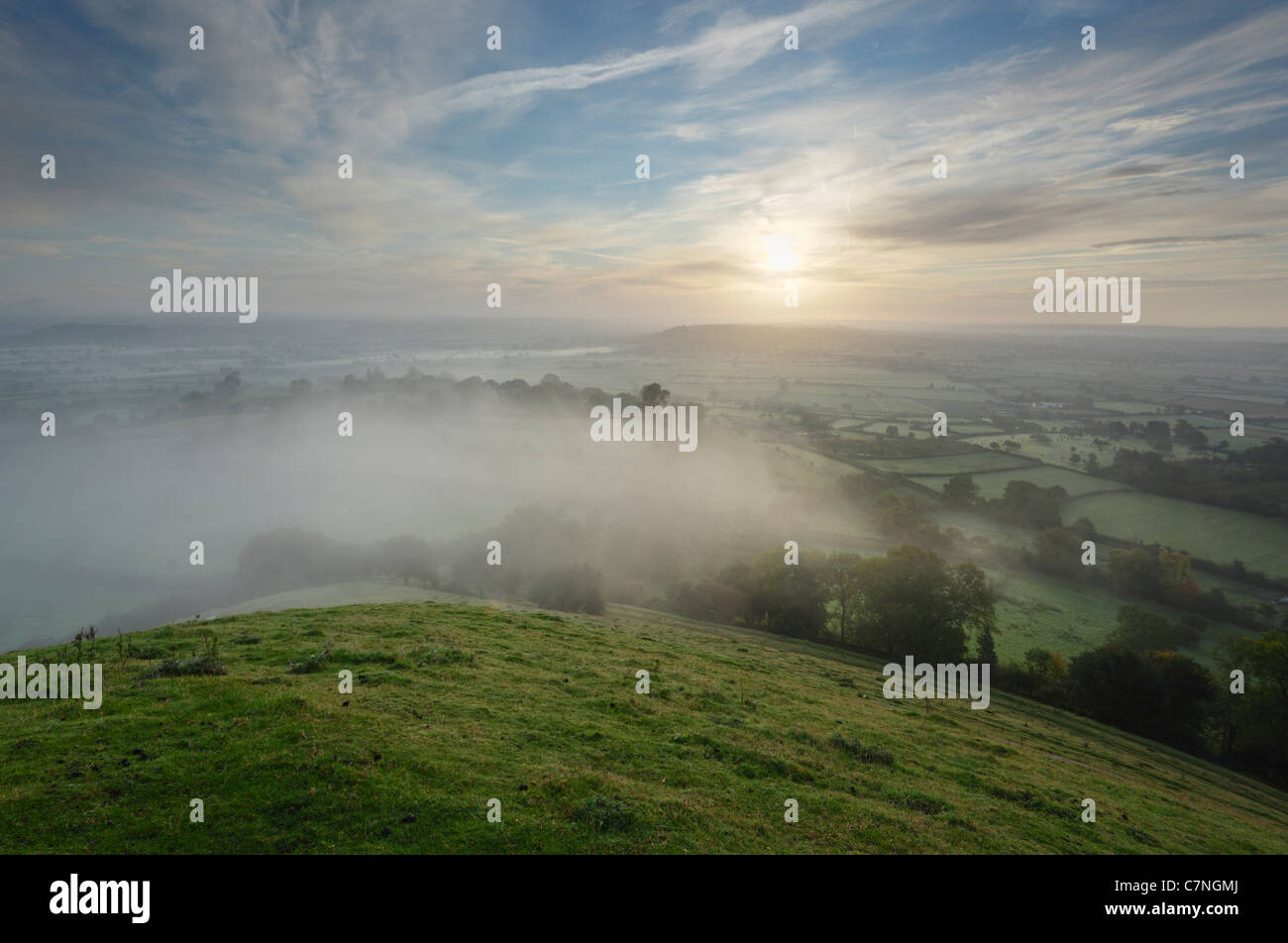 The Somerset Levels from Glastonbury Tor, soon after sunrise on Autumn Equinox. Somerset. England. UK. - Stock Image