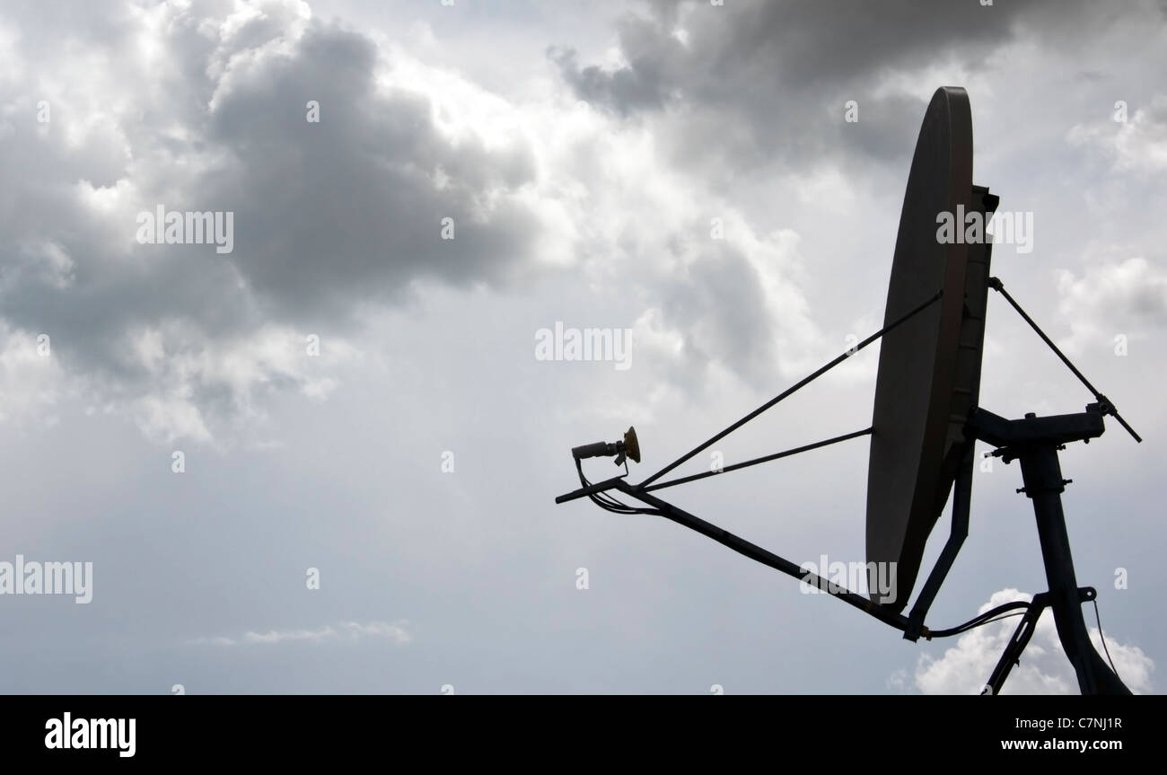 A satellite dish for receiving digital television transmissions. - Stock Image