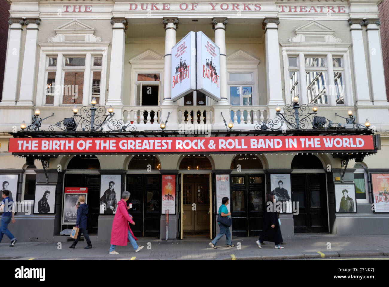 The Duke of York's Theatre London displaying an advert for the musical Backbeat about the Beatles' early days - Stock Image