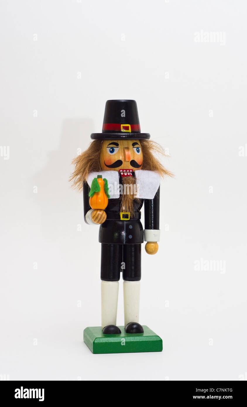 a Pilgrim Nutcracker against a white background - Stock Image