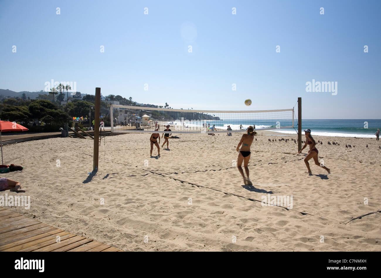 Women playing volleyball on Laguna Beach - CA Stock Photo