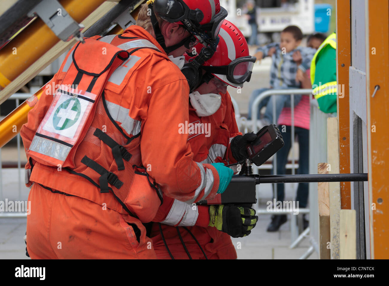 Firefighters using a Search Camera to look inside a confined space. - Stock Image