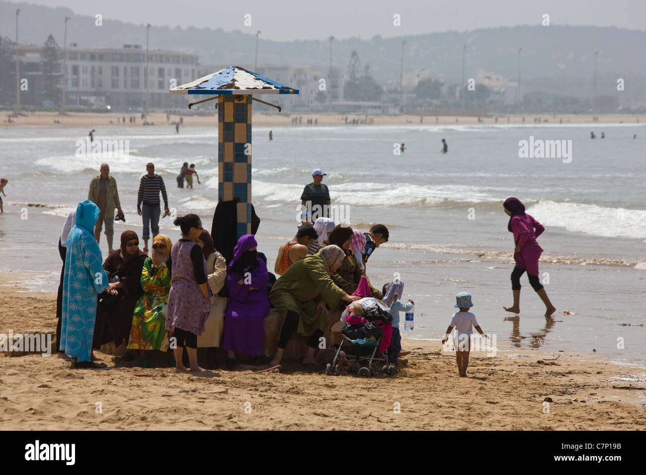 Families on the beach in Essaouira, Morocco - Stock Image
