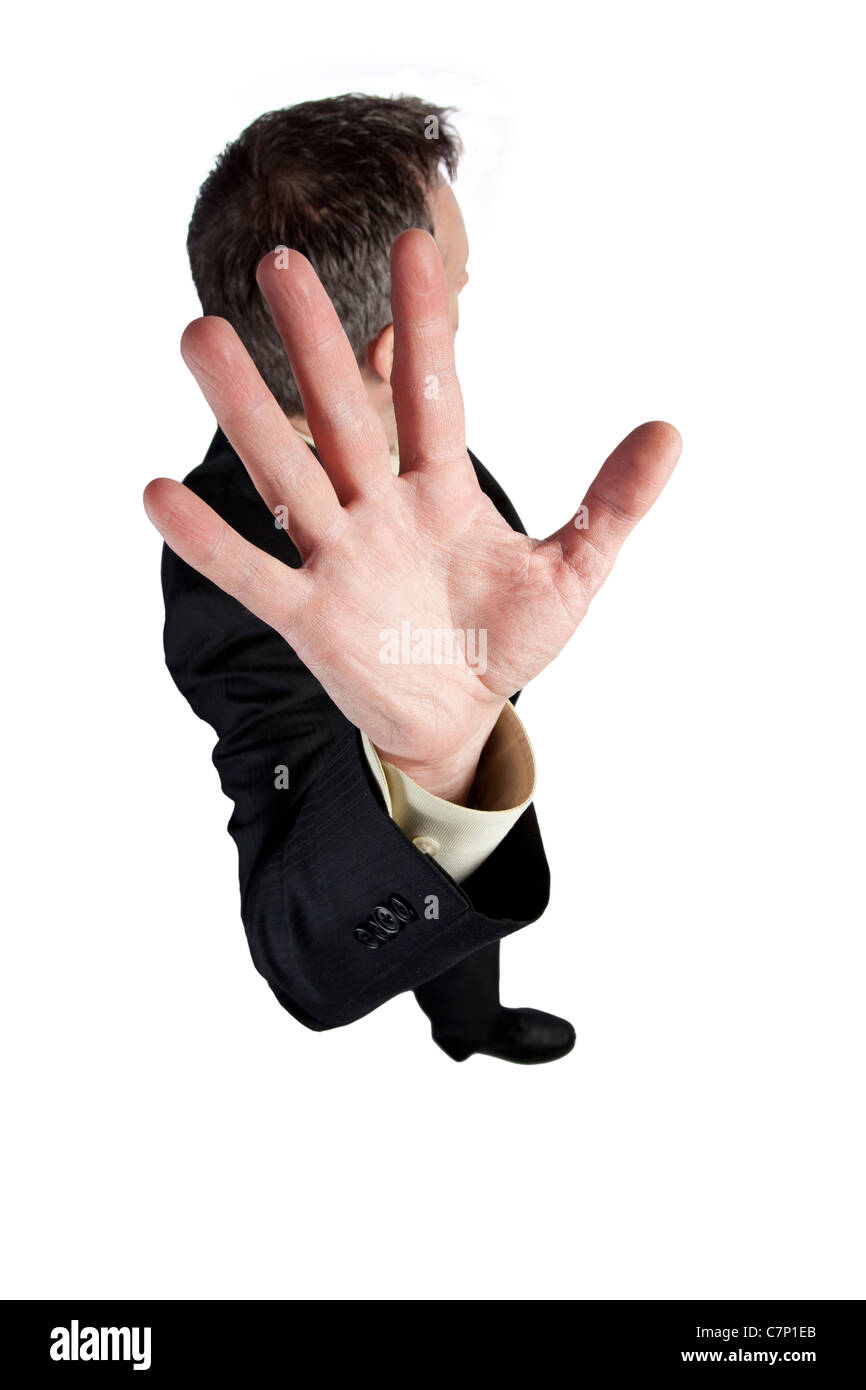Man holding out his hand and turning his head to avoid getting photographed - Stock Image