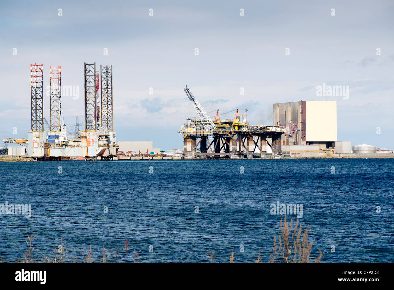Jack Up drilling rig GSF Britannia and semi submersible floating production system FPF1 at the TERRC facility Hartlepool - Stock Image