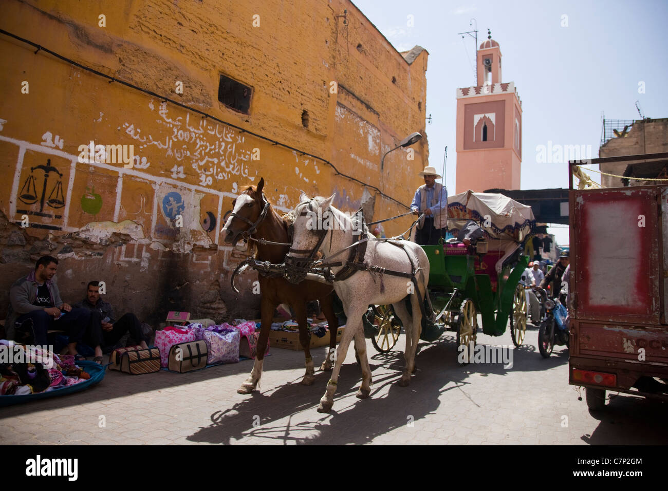 Horse and carriage in the souk of Marrakech - Stock Image