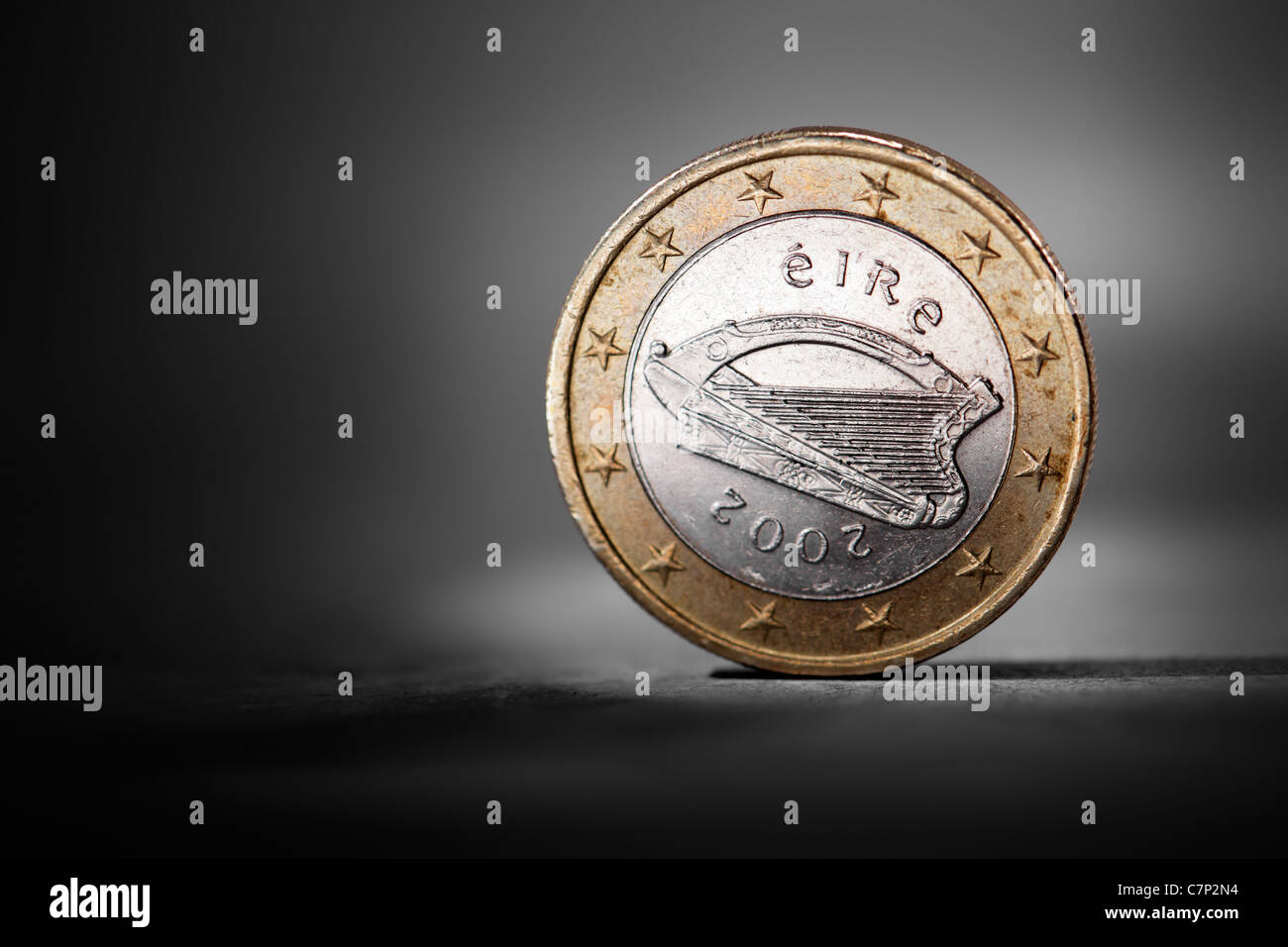 Irish one euro coin showing the national backside. Short depth-of-field. - Stock Image