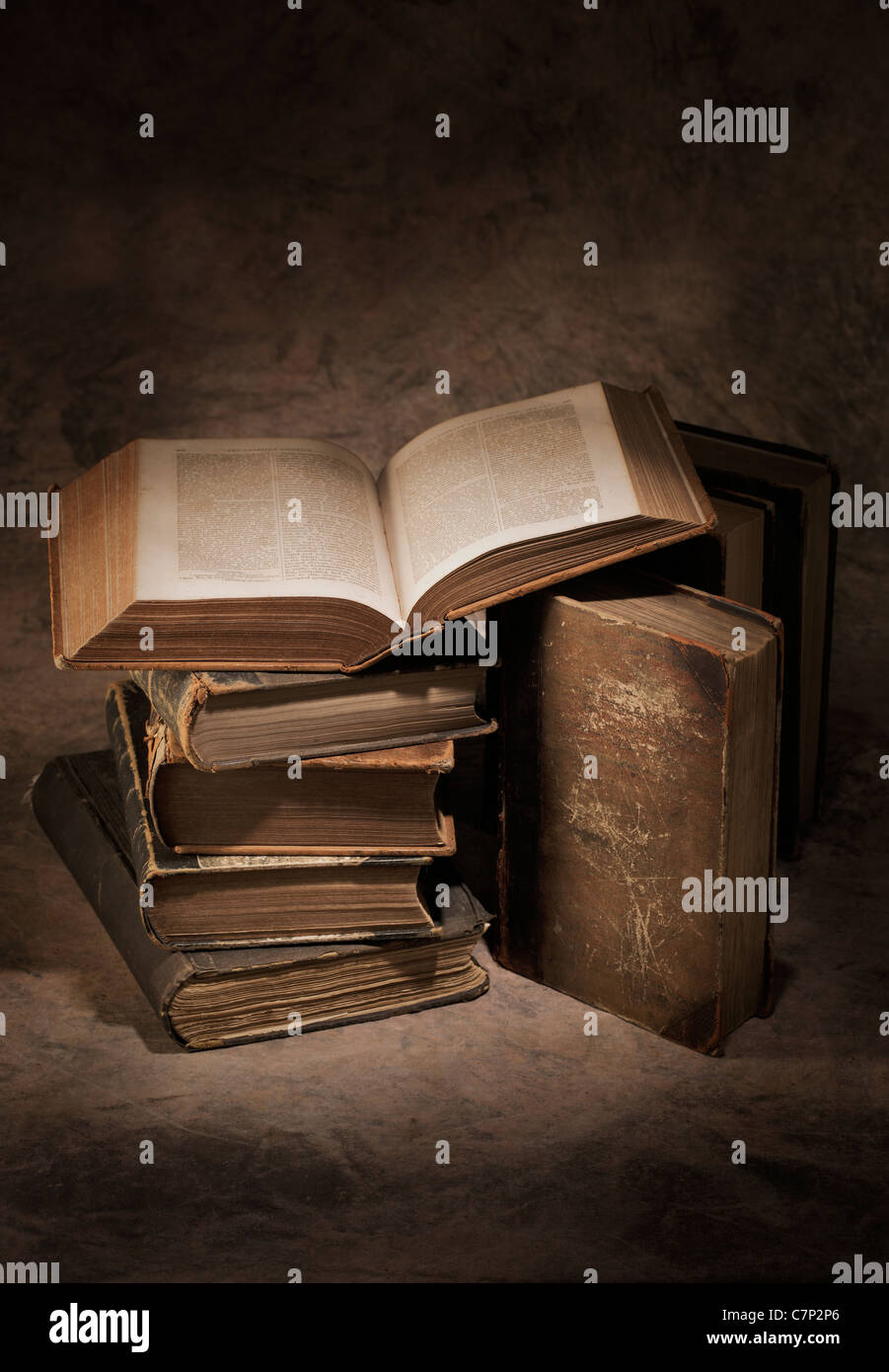 Still life of old antique books. The open book is printed in 1866. - Stock Image