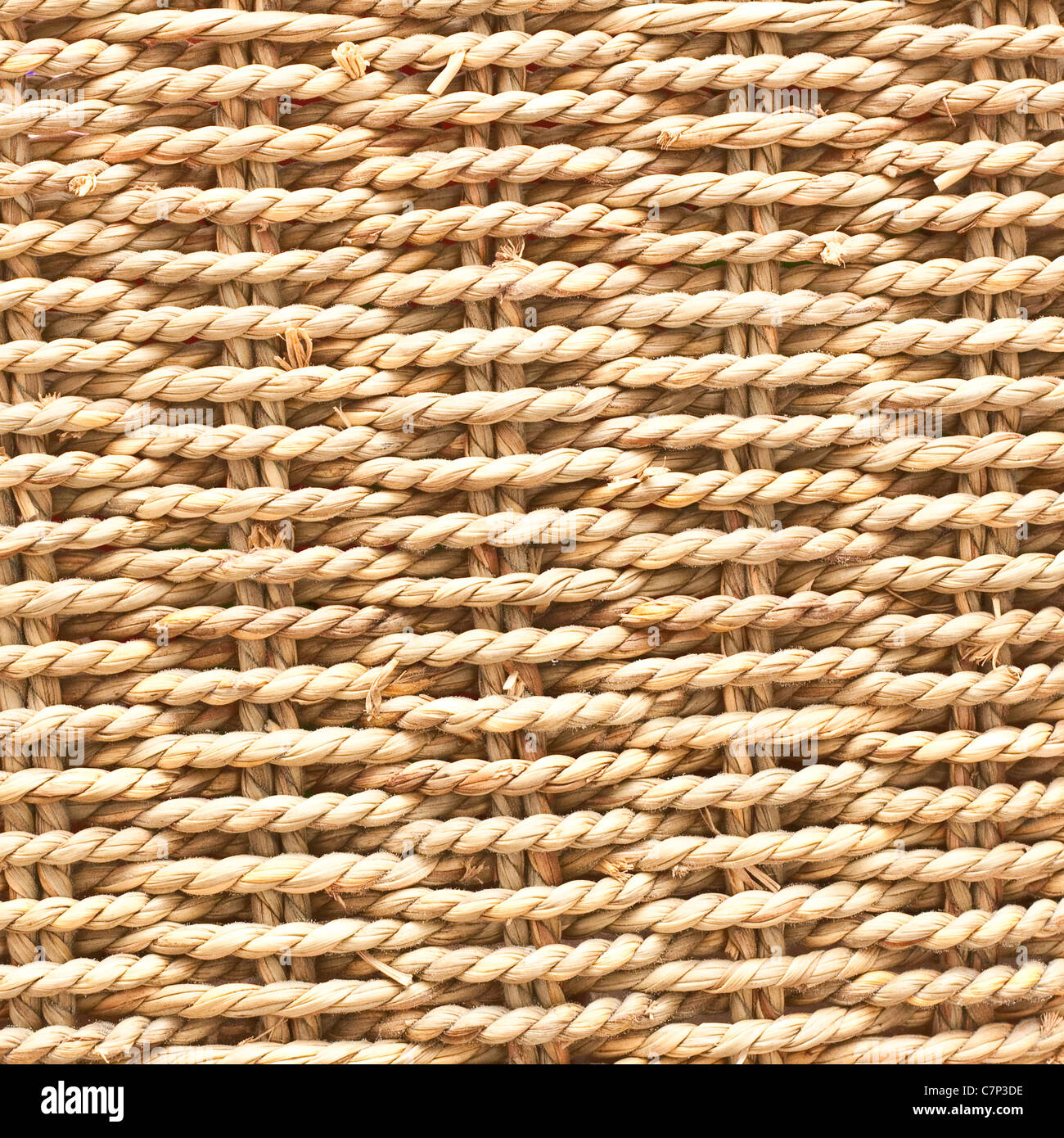 Textured basket made of natural fibres as a background - Stock Image