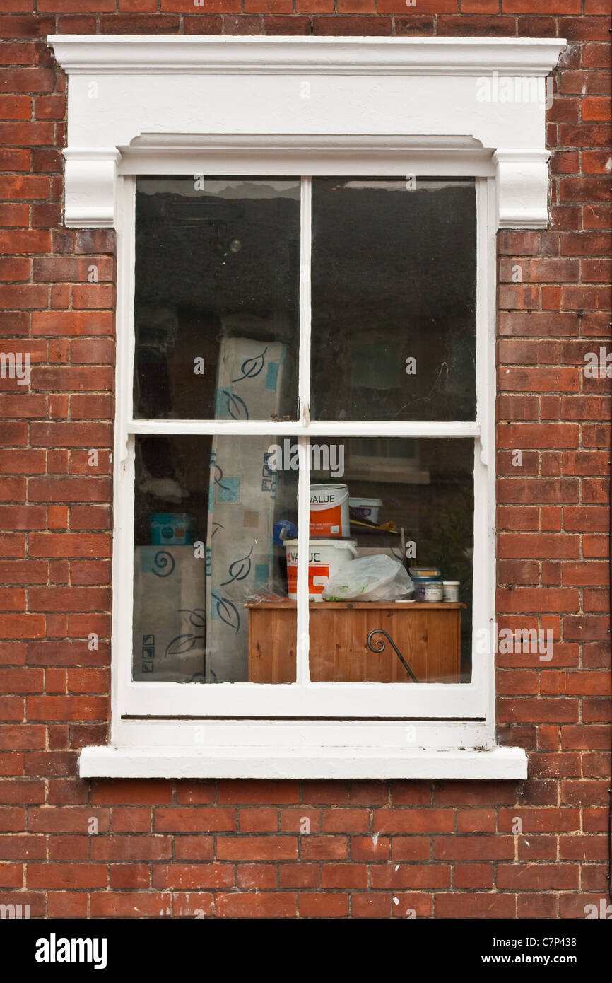Paint and upturned furniture in a house windowStock Photo