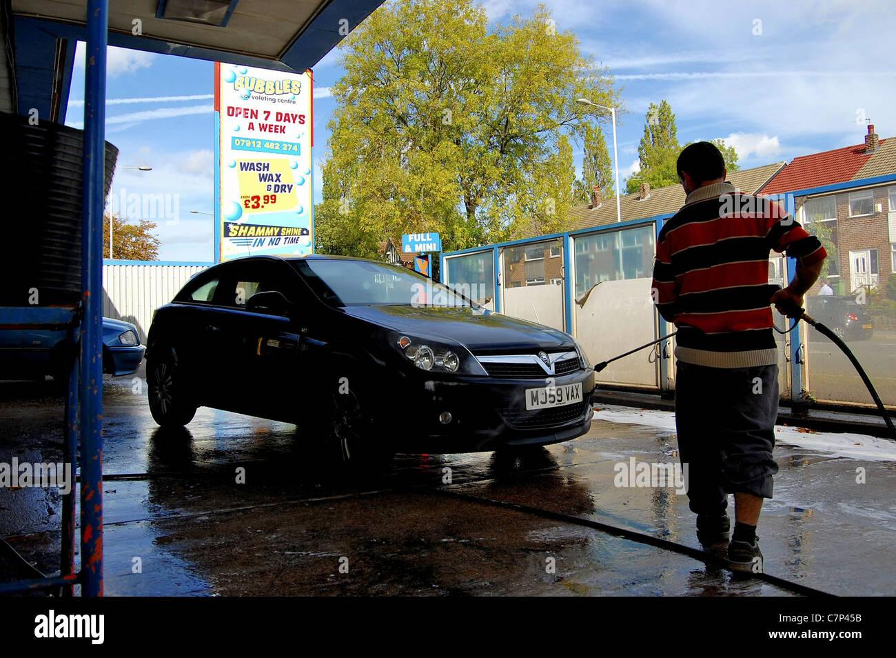 Car being sprayed at jet wash - Stock Image