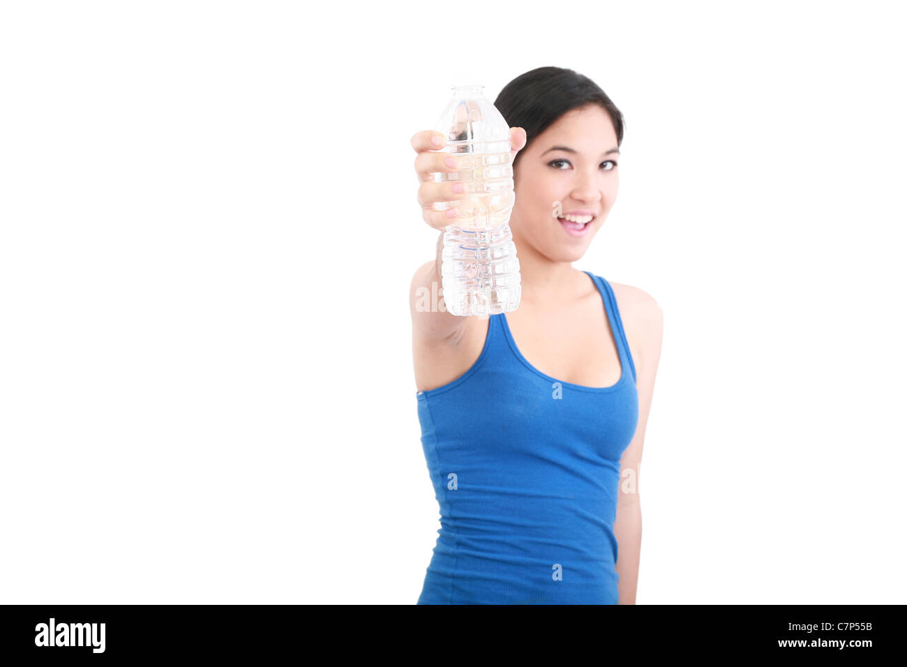 smiling young woman with water, isolated over white background - Stock Image
