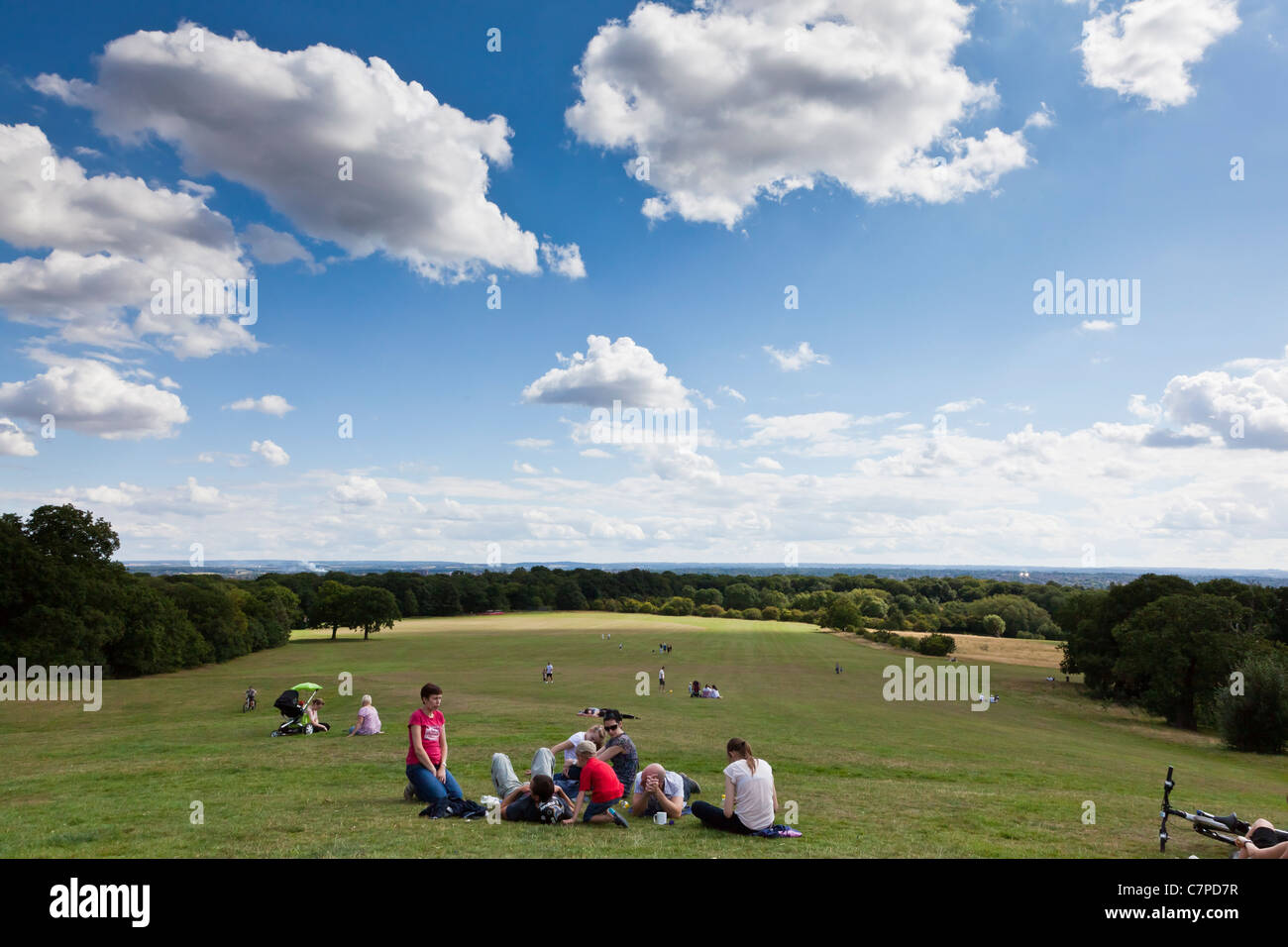 Families wait for a free band concert by Gambler at Oxleas Wood, Bexley, Kent, UK - Stock Image