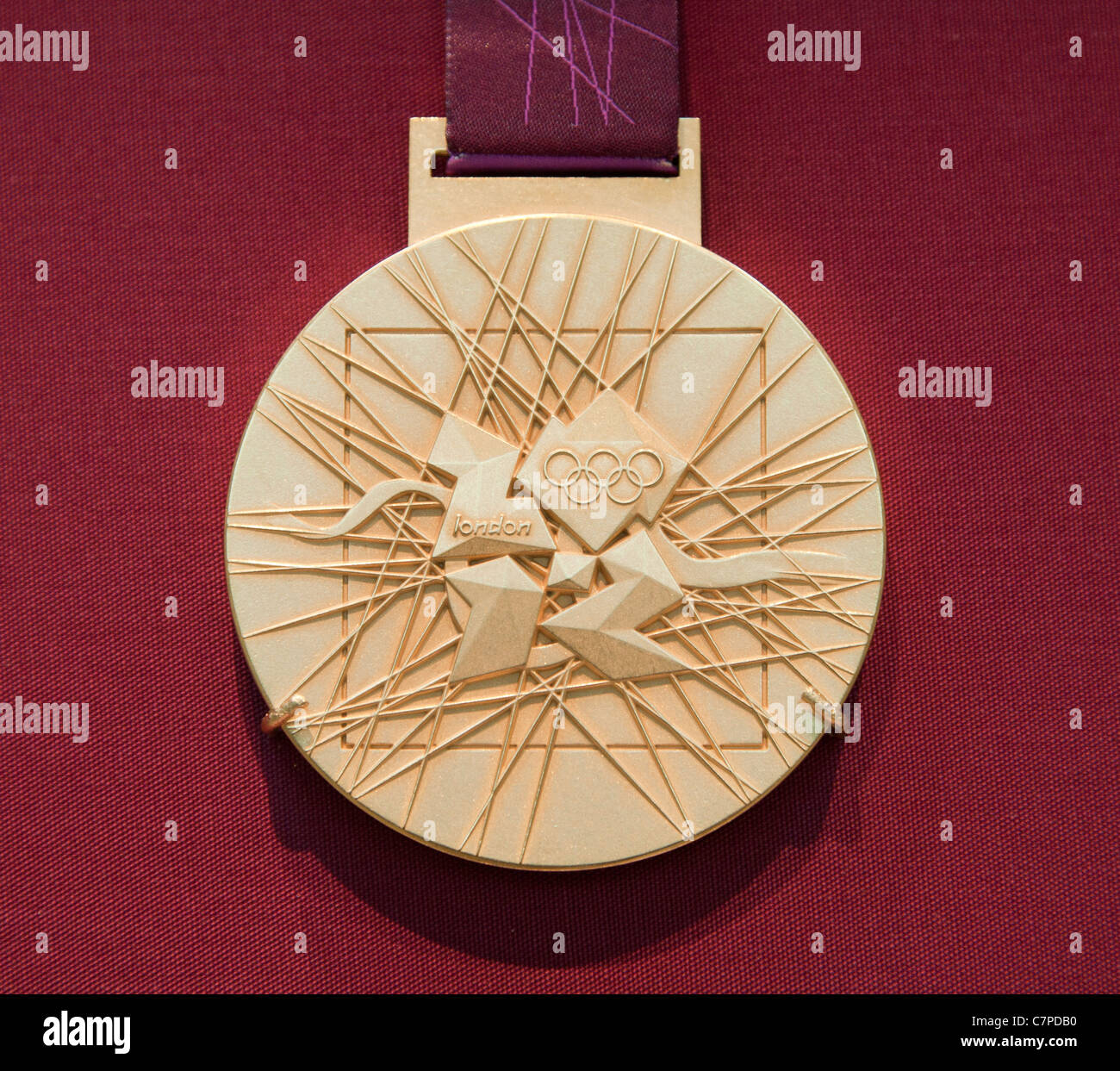 The rear view of the 2012 Olympic Games Gold Medal on display in the British Museum in London - Stock Image