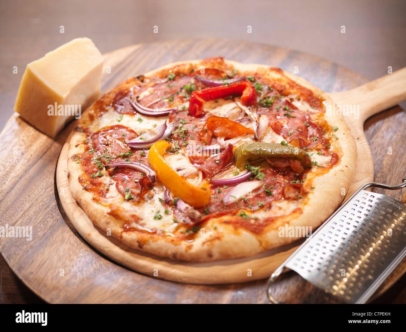 Plate of artisan pizza in restaurant - Stock Image