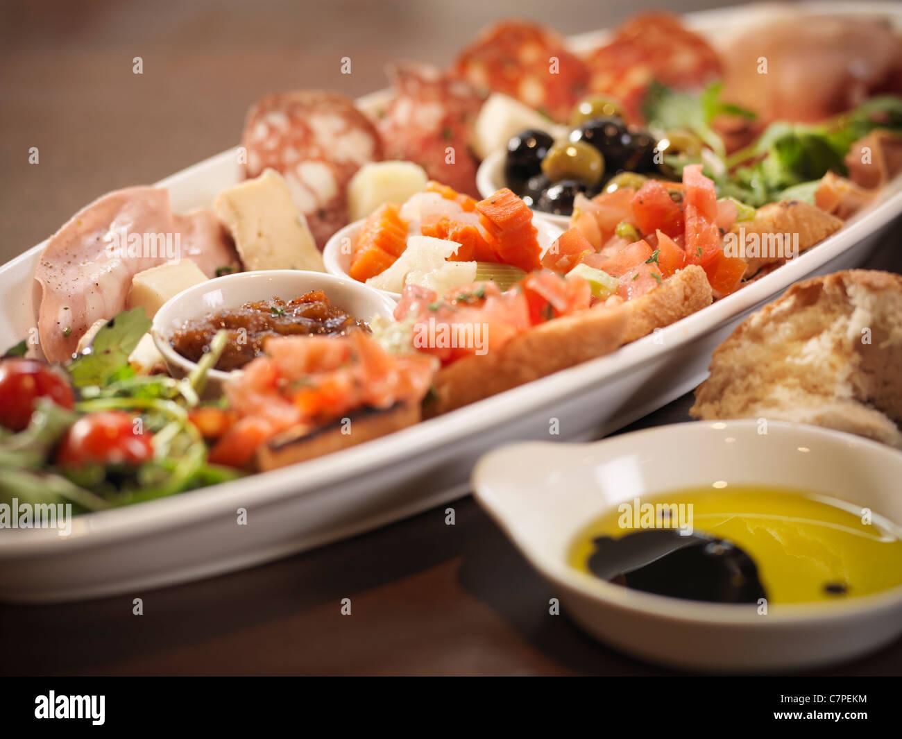 Plate of antipasto in restaurant - Stock Image