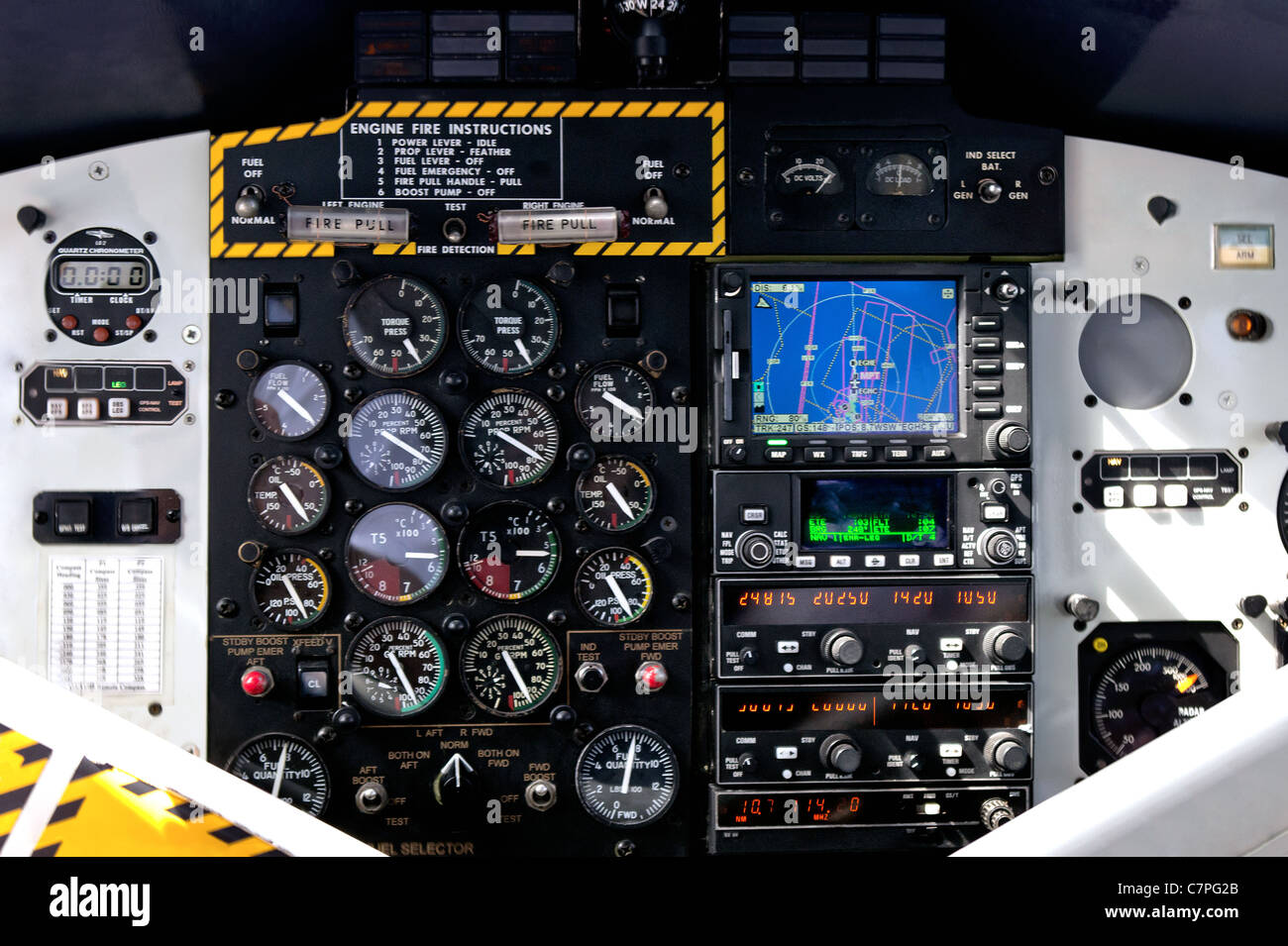 Photo of the instrument control panel in the cockpit of a twin propeller airplane. - Stock Image