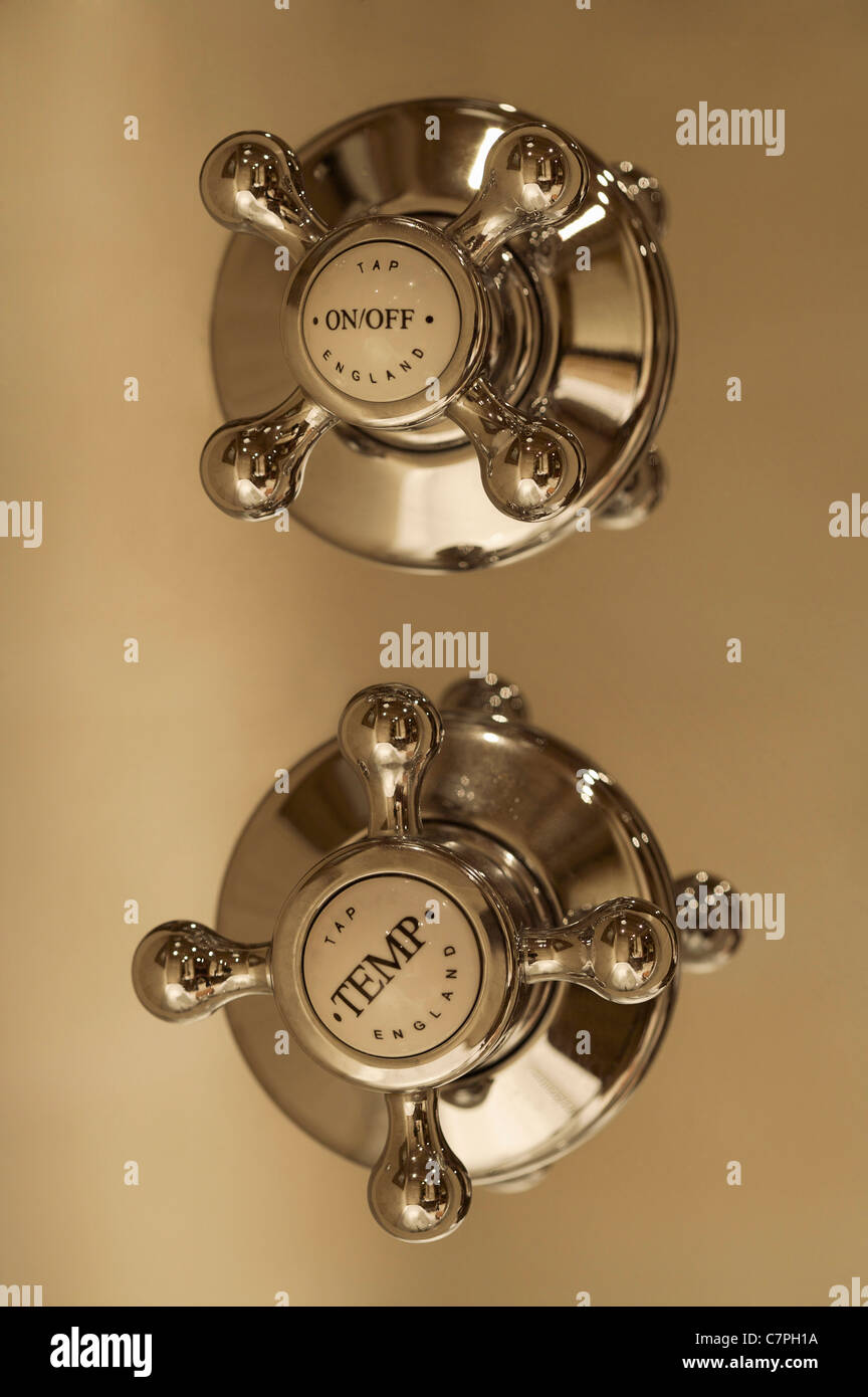 Close up of shower faucet handles - Stock Image