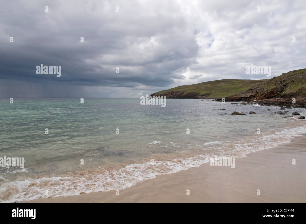 An area of heavy showers approaching the Bay of Stoer on Scotland's northwest coast. - Stock Image