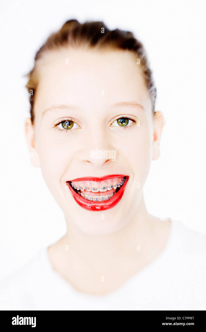 Woman in braces wearing red lipstick Stock Photo