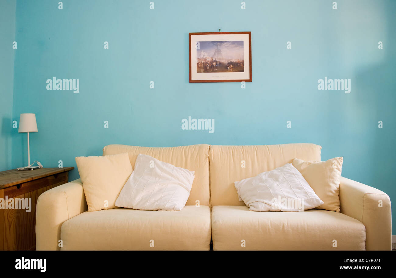 White sofa in modern home - Stock Image