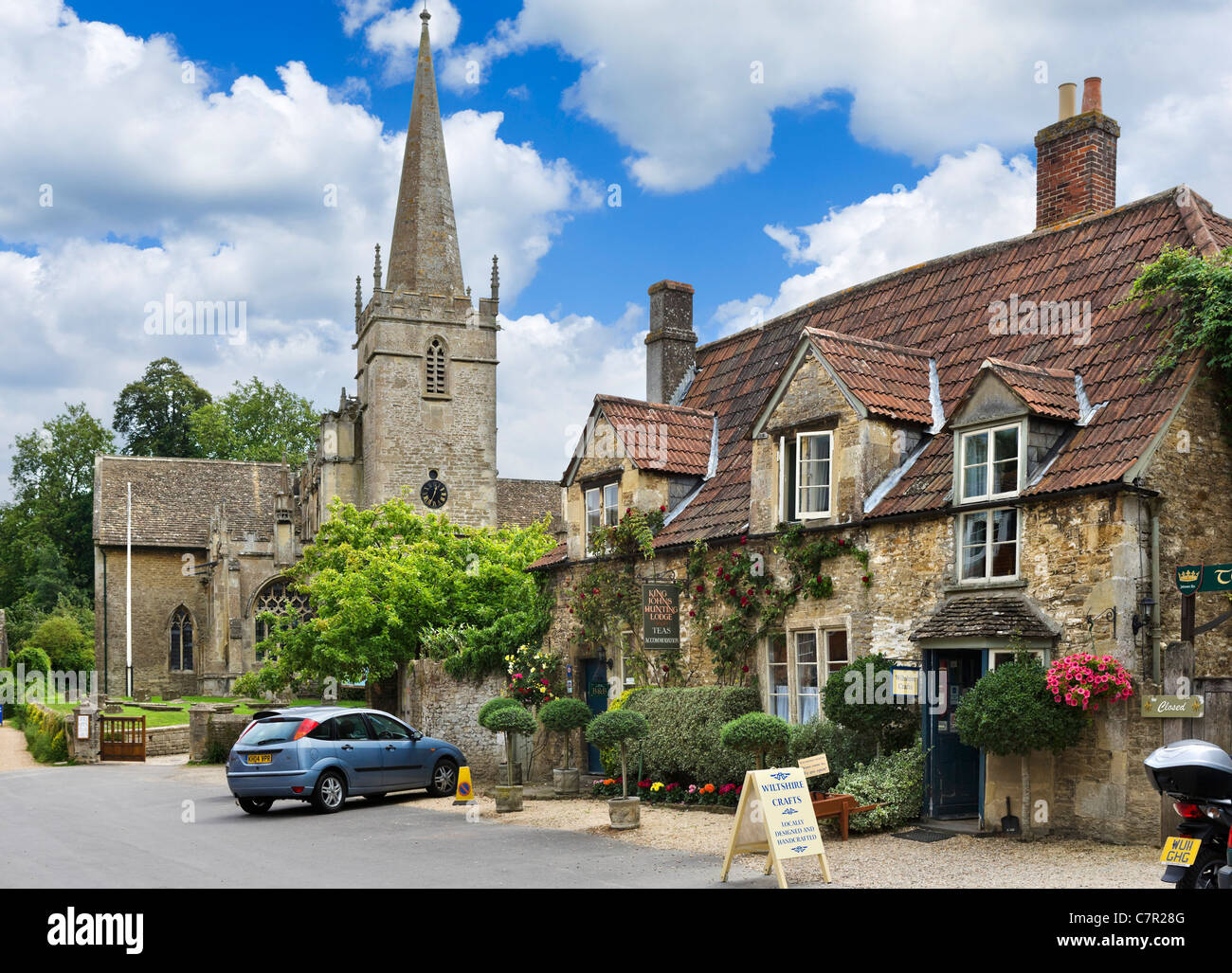 Tea Room and craft shop in front of the Church of St Cyriac in the picturesque village of Lacock, near Chippenham, Stock Photo