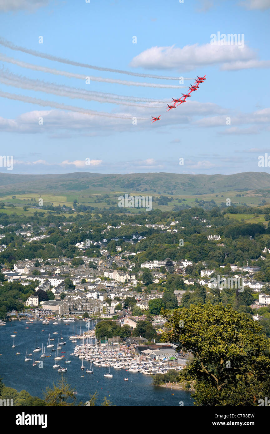 Red Arrows Royal Air Force Aerobatic Team fly in formation above Bowness during Windermere Air Festival, Cumbria, - Stock Image