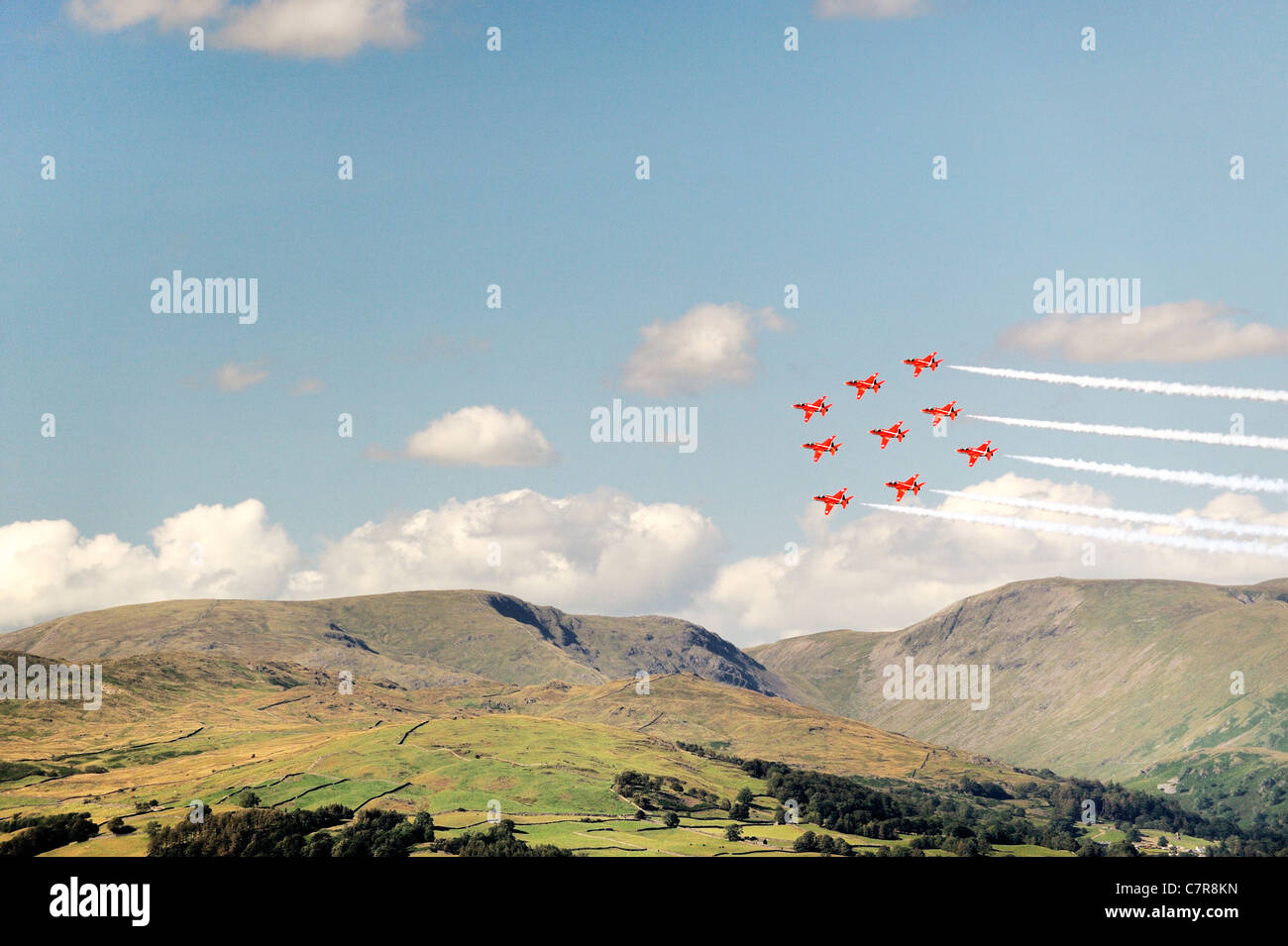 Red Arrows RAF Aerobatic Team fly their Diamond Nine trademark formation above the Troutbeck fells. Windermere Air - Stock Image