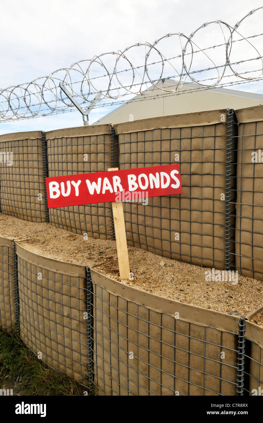 Old-fashioned Buy War Bonds sign in barricade with barb wire on military base. USA. - Stock Image