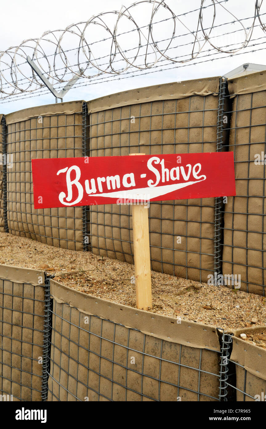 Nostalgic Burma shave sign in barricade with barb wire fencing on a military base. USA - Stock Image