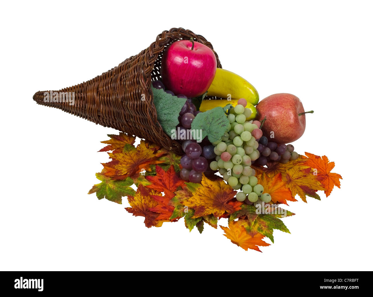 Wicker horn cornucopia which is symbolic for plentiful abundance with colorful fruit and leaves - path included - Stock Image
