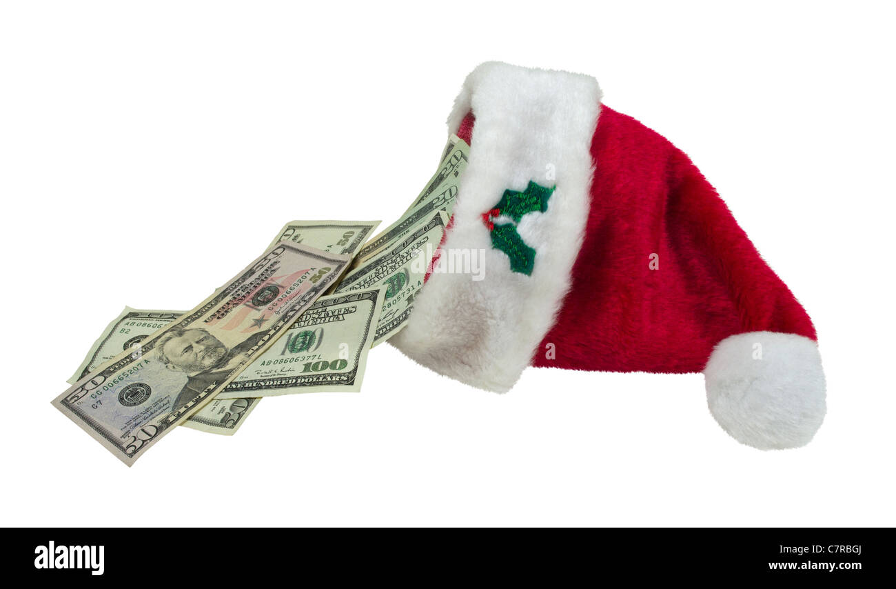 Money pouring from a traditional red Santa hat with white trim - path included - Stock Image