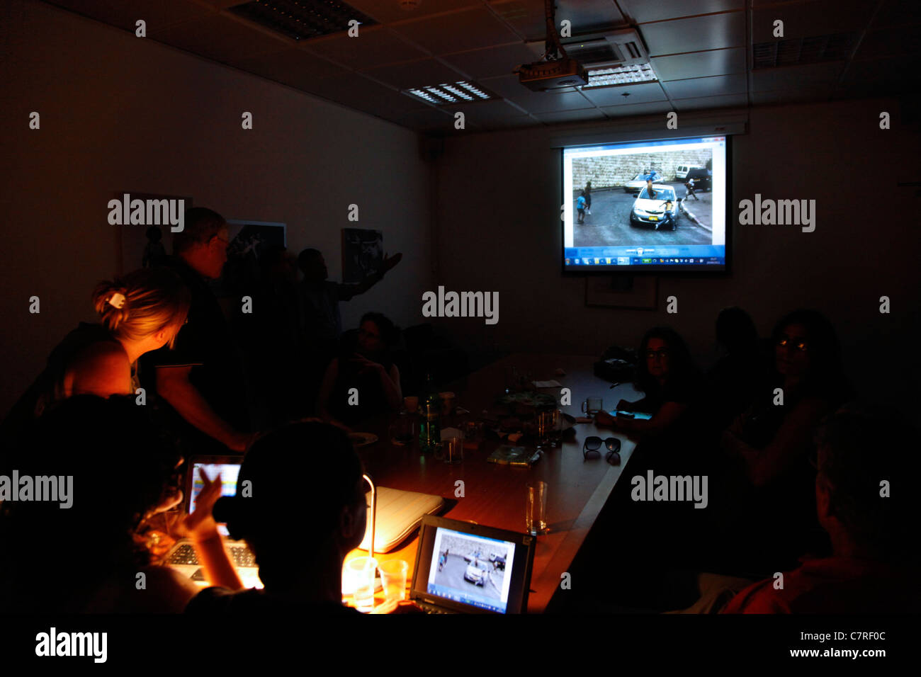 Jury Members watching a photograph screened during 'Local testimony'' photojournalism contest in Eretz - Stock Image