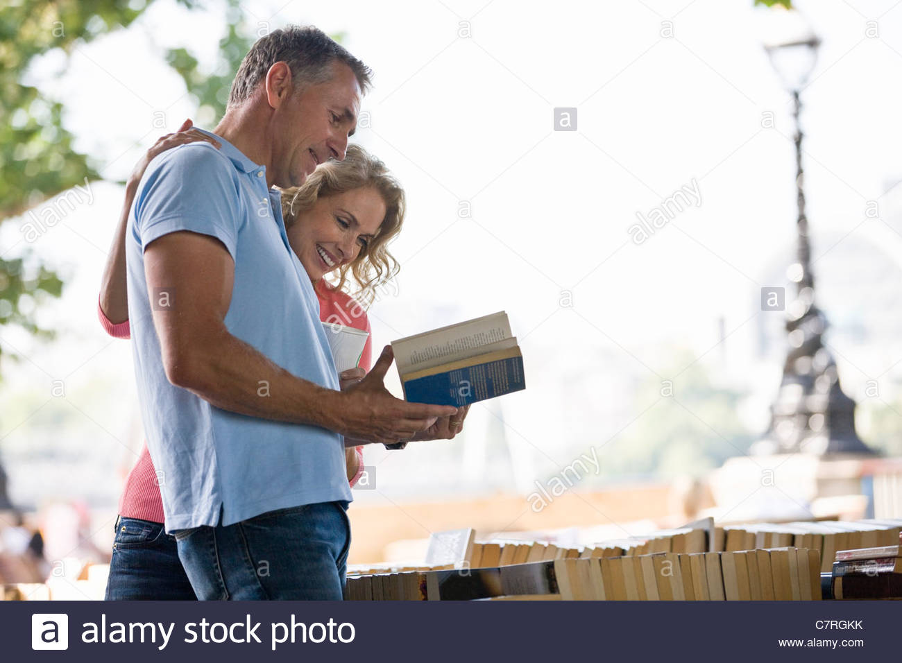 A middle-aged couple looking at books at a book stall - Stock Image
