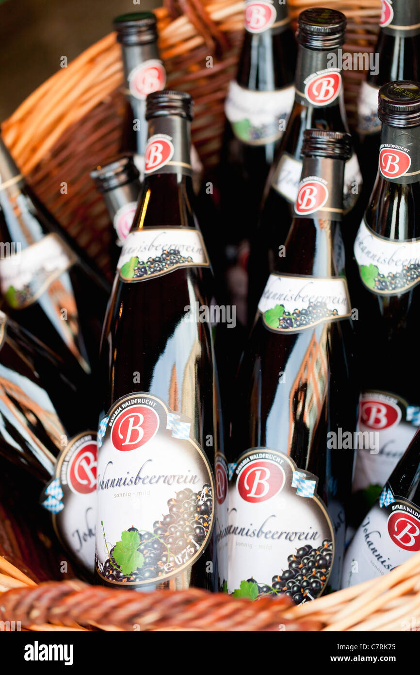 Close up of schnaps bottles at a local specialty food shop - Berchtesgaden, Bavaria, Germany, Europe - Stock Image