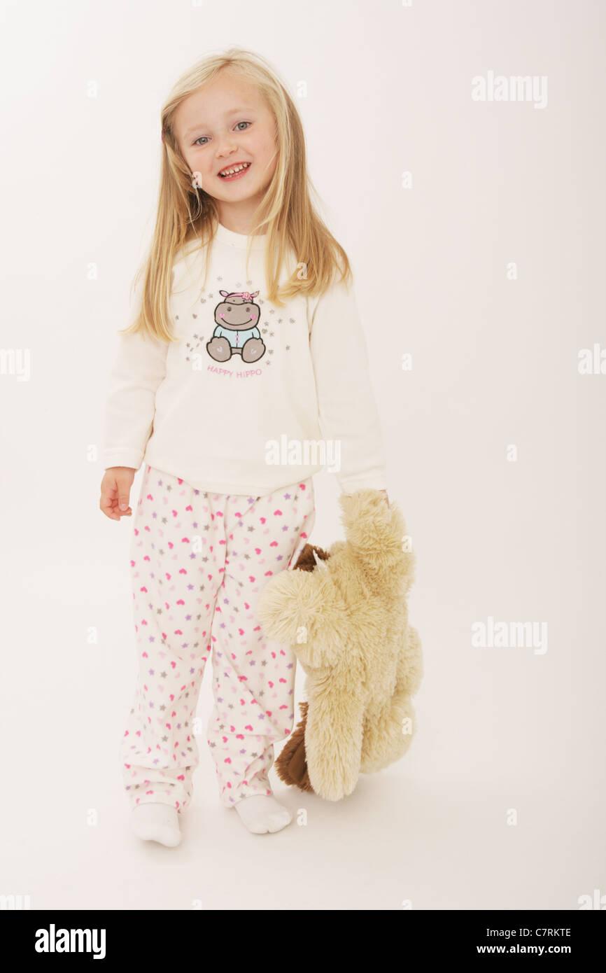 Five year old girl wearing pajama's. - Stock Image