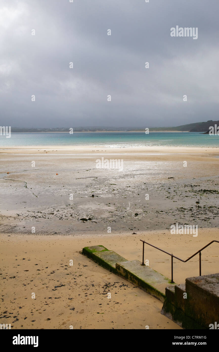 A deserted tranquil beach on a moody day, St Ives, Cornwall. - Stock Image