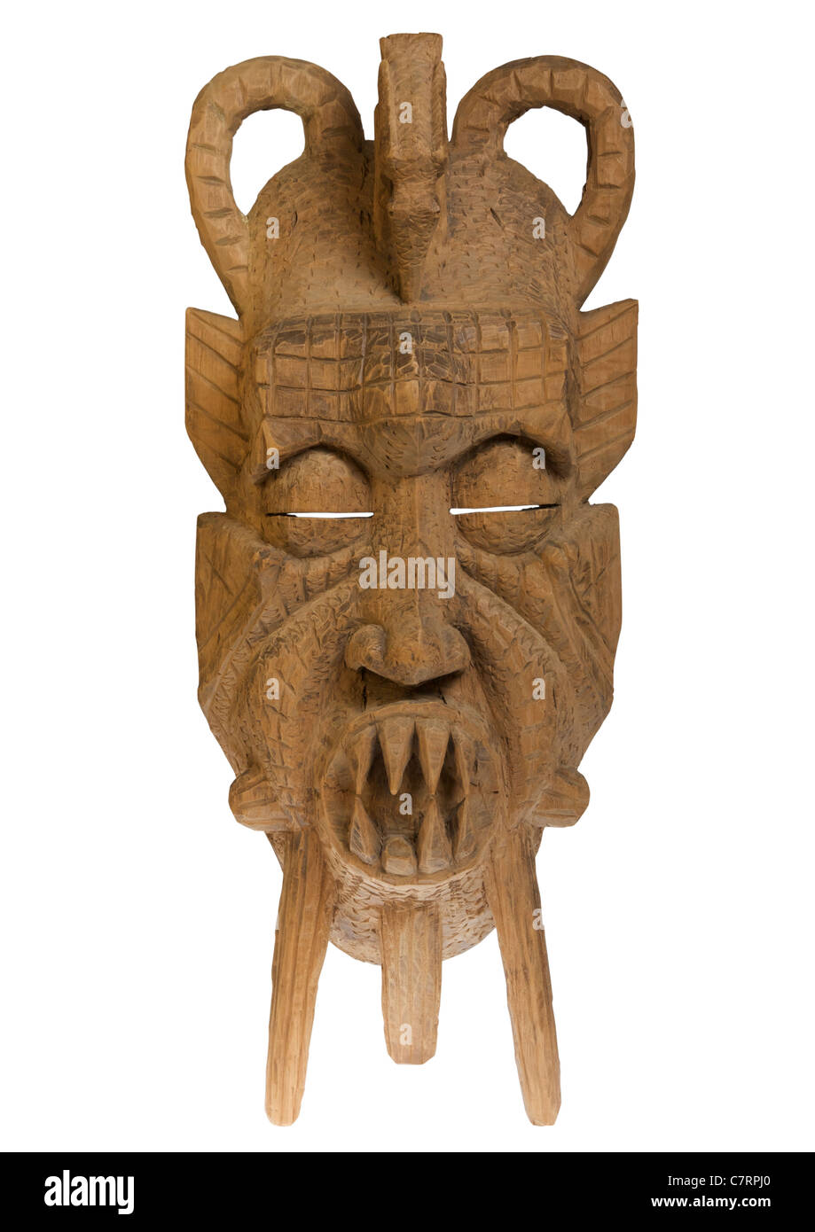 Carved wooden Ghanaian mask on white background - Stock Image