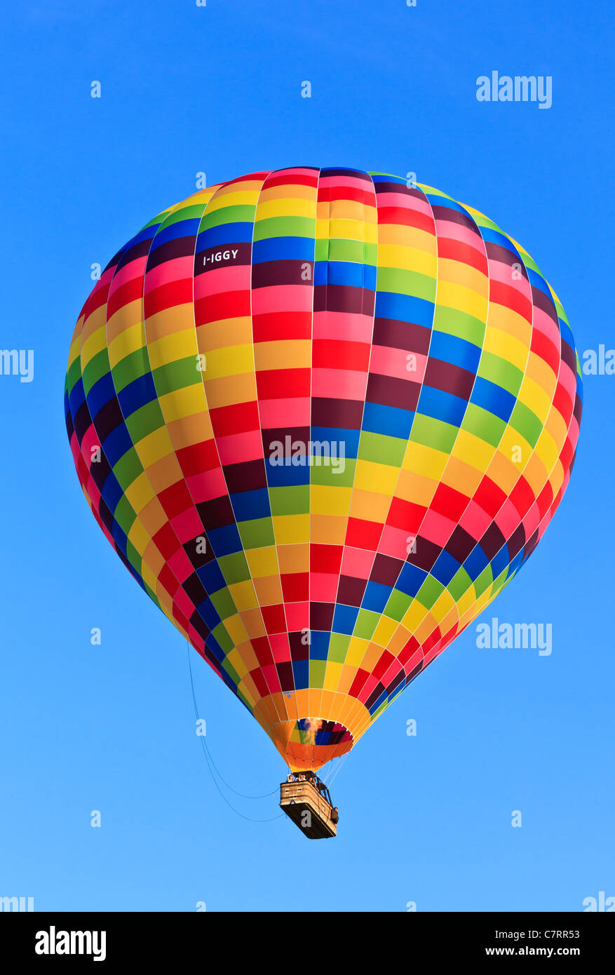 Hot air balloon drifting on a calm sunny afternoon Stock Photo
