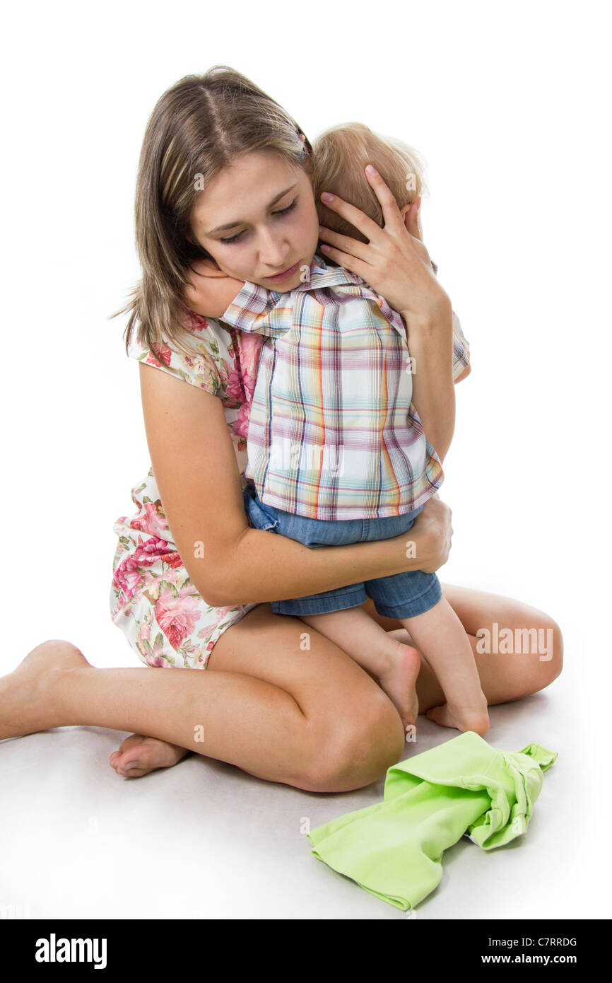 Careful and gentle mother. The son cries - mother calms him and embraces. - Stock Image