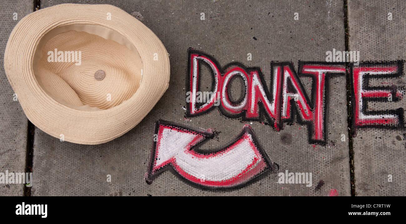 Donate Graffiti Sign on the PavementStock Photo