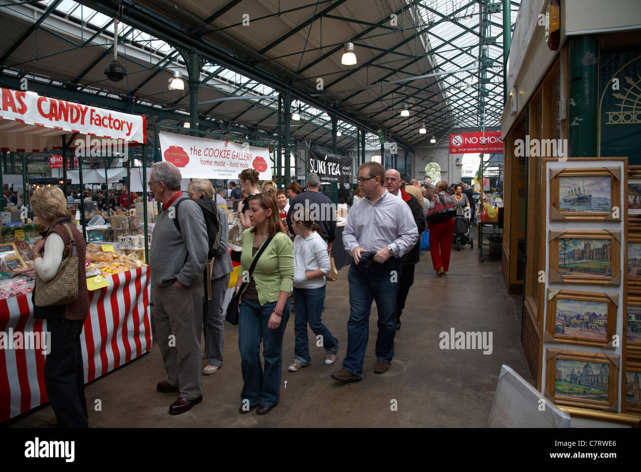 Vistors wander through the stalls at the City Food and Garden Market held every Saturday at St Georges Market, Belfast, - Stock Image