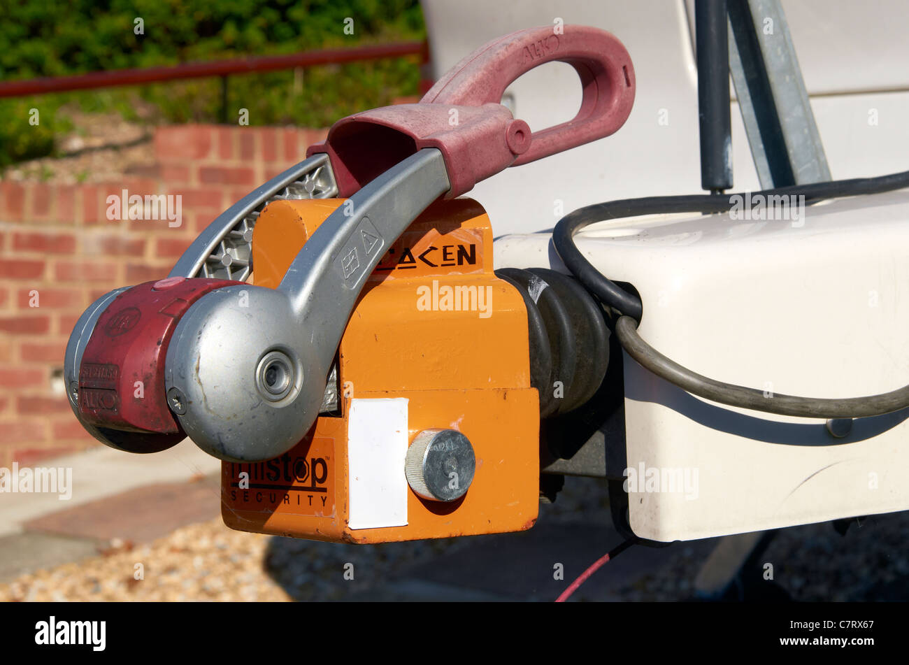 A robust caravan hitch lock on an Alko stabiliser hitch providing a high level of security during caravan storage - Stock Image
