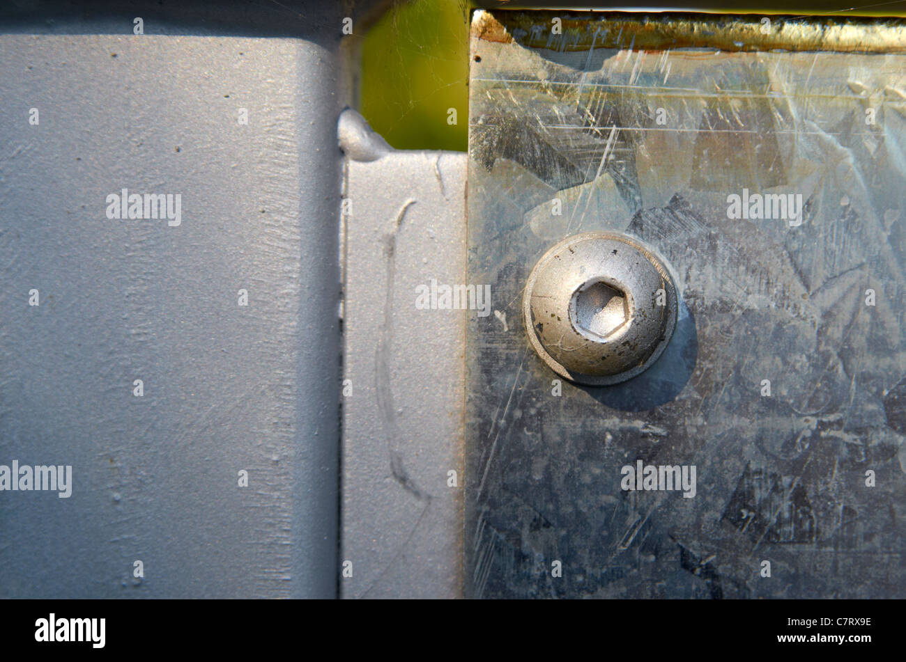 Allen bolt used to secure safety panel to the framework of a footbridge over a railway line. - Stock Image