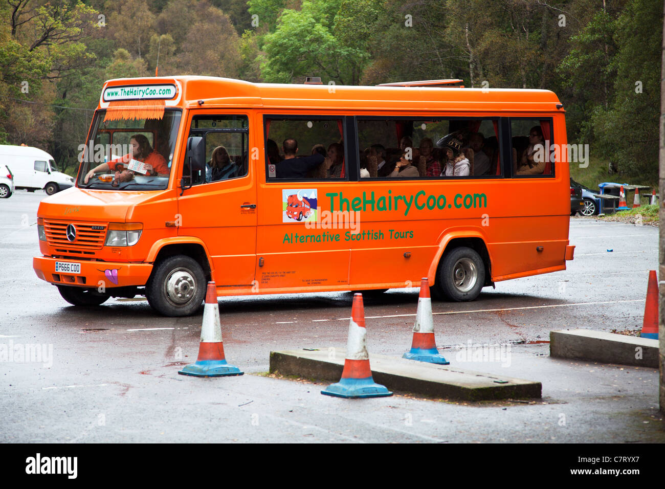 The hairy coo .com tour bus at a parking spot Loch Katrine Scotland, Scottish holiday travel alternative - Stock Image